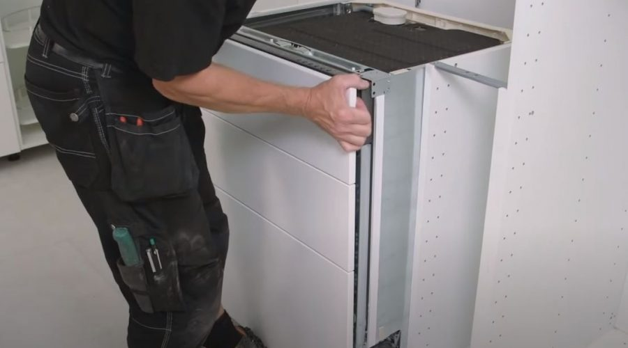 install a fully integrated dishwashing machine