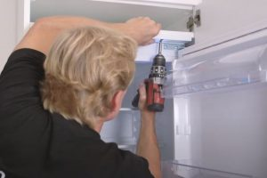 Then plug in and place the refrigerator in the high cabinet